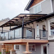 Glass canopy and patio railing